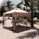 Relaxing massage on the beach.