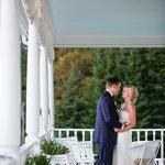 The grand porch is an inviting spot to relax and for taking that special photograph