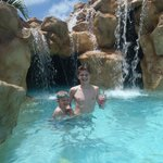 boys enjoys a drink at the waterpark