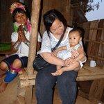 A Karen LongNeck young women and her baby