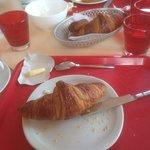 Breakfast...on red plastic trays !!