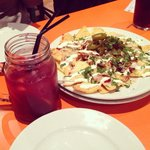 Pulled pork nachos with a fancy glass of sangria 🍷