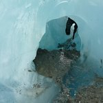 Crawling through an ice cave (this was optional on our trip)!