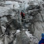 Cutting steps to ascend the glacier