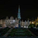 Jardin du Mont des Arts at night with view of Grand Place Tower