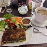 Spinach quiche with regular coffee.