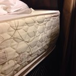 Pillow top on bottom and hard side where hotel guest sleeps. Who does the housekeeping here and