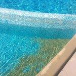 Arena en la piscina