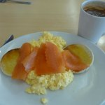 Smoked salmon and scrambled egg on a muffin