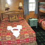 The bedroom with a double and bunk beds beside for the kids