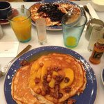 Pancakes with nuts, peaches and syrup