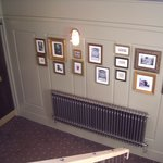many framed pictures in rear hall and staircase to loos