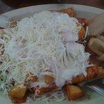 Enmoladas with cueritos and cream