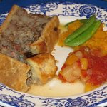 traditional Quebecois pie made with bison, elk, and other wild game