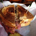 Reuben sandwich and dill pickle slices