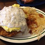 Eggs on chicken fried steak on a biscuit covered in sausage gravy!