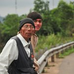 Mr. Dung & Mr. Thang during a break from riding to stretch our legs & take in the scenery
