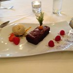 chocolate torte with coffee ice cream and pistacio