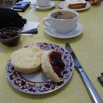 Long black and a scone with plum jam