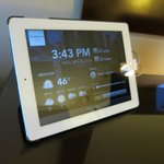 iPad in the room with alarm clock and room service menu. Nice touch!