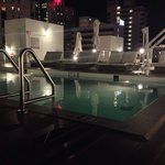 The pool at night, but lacking the planting !