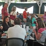"""Pic of the """"inside"""" dining area.   Access to outside tables through this area."""
