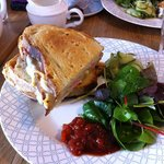 Delicious toasted ham and cheese with salad and pickled cucumber.  Mouth watering soooooooo good