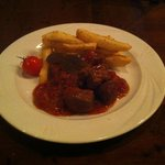 Beef stew (stifado) with fried potatoes
