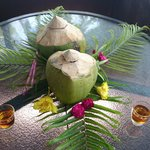 Fresh Coconut with a Shot of Rum to Welcome you!