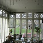 The sunroom provides pretty views while eating or having a small meeting.
