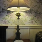 oil lamp with lilac wallpaper