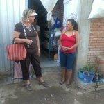 Explaining her business plan for her corner store
