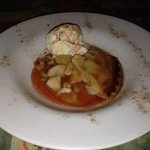 Home made apple pie with rum sauce