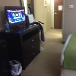 Nice tv and area to walk to the closet
