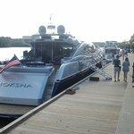 Yachts docked along the boardwalk