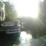 The sun shines bright over the canal