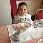 Taylor with her Peppa Pig breakfast setting