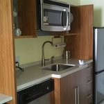 Fully stocked kitchen with dishwasher, fridge and freezer, microwave, plates/utensils - no cookt