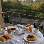 Room service with breakfast. Eating on the balcony. Super romantic
