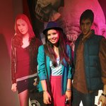Lifesize cardboard cutouts of the actors
