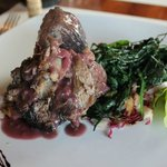 Lamb in brunello sauce and wild spinach