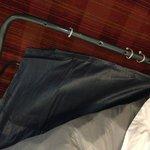 Broken sleeper sofa held together with zip ties