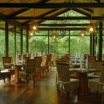 Panoramic windows frame the farm-to-table culinary experience.