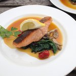 Beautiful salmon with a fresh orange glaze. The chef knows what he is doing!