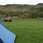 View from lower fields. That's the toilet block in the distance above the maroon car.