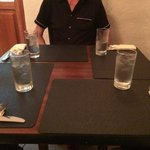 Small table for 4 adults. You have to put your elbow on top of the neighbors napkin.