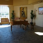 More lobby with baby grand piano.