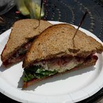 Chicken salad with lettuce and a cranberry spread on toasted wheat