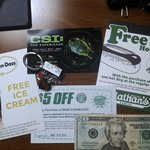 various coupons, $20, and 'dexter' keychain i got.. not shown: rainforest cafe and tv store coup