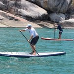 2 of us SUPing along side the boat on Koh Phangan